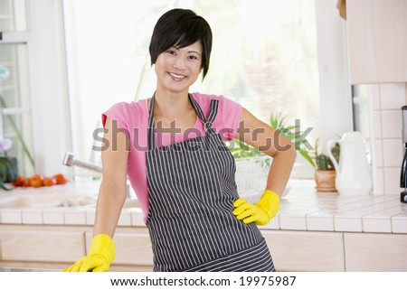 Woman Wearing Rubber Gloves - stock photo
