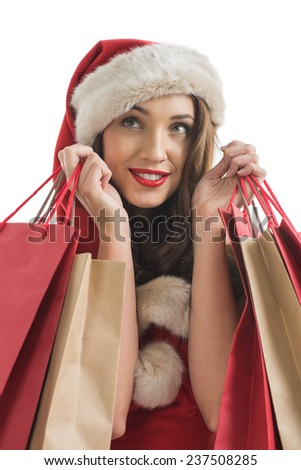 Woman wearing Santa Claus hat with shopping bags