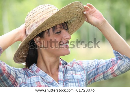Woman wearing straw hat - stock photo
