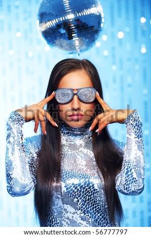 Woman wearing stylish singlasses in the disco club - stock photo