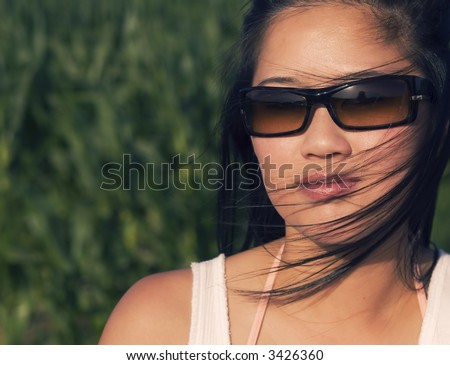 Woman wearing sunglasses - stock photo