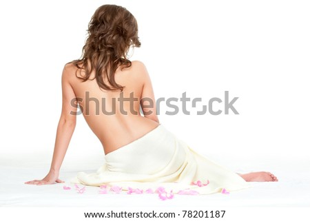 woman wearing towel  sitting on the floor back view