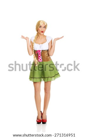 Woman wearing traditional Bavarian dress with open hands. - stock photo