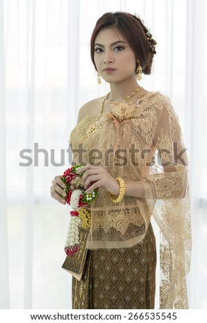 Woman wearing typical thai dress with thai style  identity culture of thailand. - stock photo