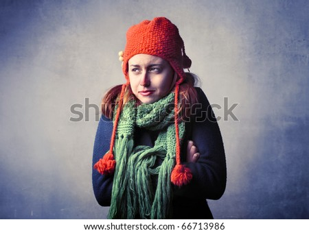 Woman wearing winter clothes feeling cold - stock photo