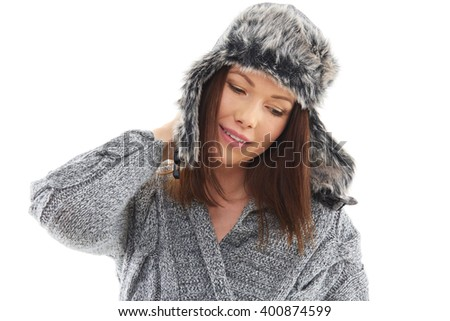 Woman wearing winter fur hat isolated over white background - stock photo