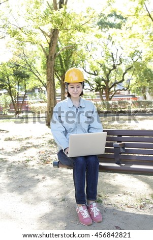 Woman wearing work clothes that are in the park