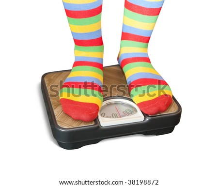 Woman weighing herself on a bathroom scale - stock photo