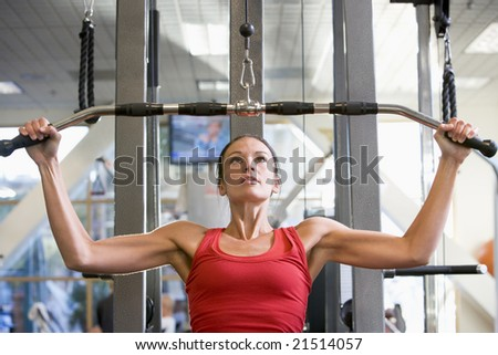 Woman Weight Training At Gym - stock photo