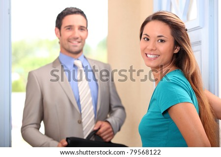 Woman welcoming her husband home - stock photo