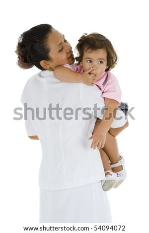 woman who could be her mother, nurse, nanny or teacher holding a sweet 2 girl, isolated on white background - stock photo