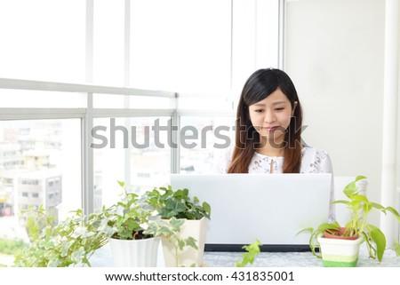 Woman who enjoy the laptop computer - stock photo
