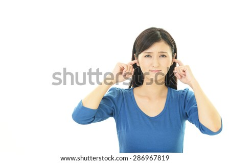 Woman who holds her ears