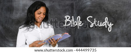 Woman who is happy to be studying the Bible