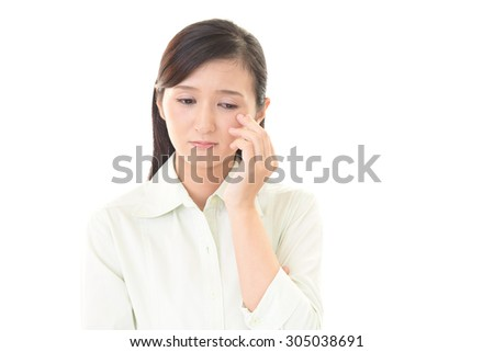 Woman who is worried - stock photo