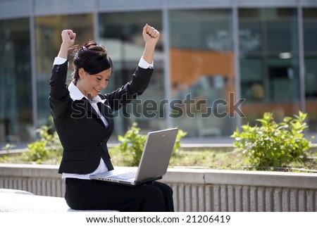 woman win working at a laptop - stock photo