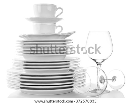 Woman wiping the dishes on white background - stock photo
