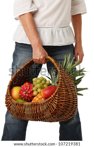 Woman with a basket of fruit and vegetables - stock photo