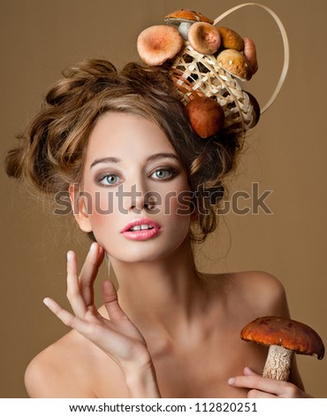 woman with a basket of mushrooms - stock photo