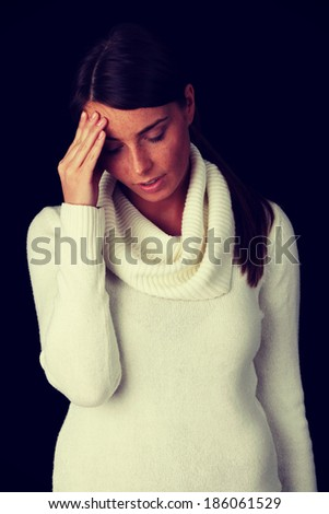 Woman with a big headache (isolated on with with copy space)  - stock photo