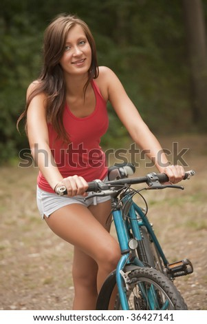 woman with a bike in the forest
