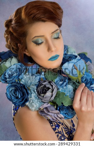 Woman with a blue rose - stock photo