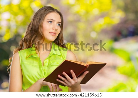 Woman with a book on her hands