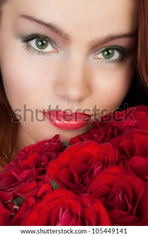 woman with a bouquet of red roses - stock photo