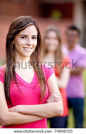 Woman with a casual group of friends - outdoors - stock photo