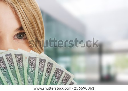 Woman with a clip of polish money - stock photo