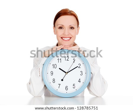 Woman with a clock smiling to you. White background