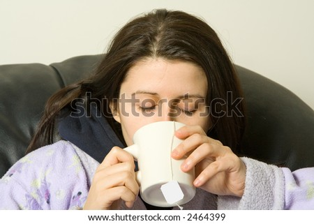 woman with a cold drinking a hot tea - stock photo