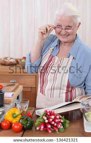 Woman with a cookbook - stock photo