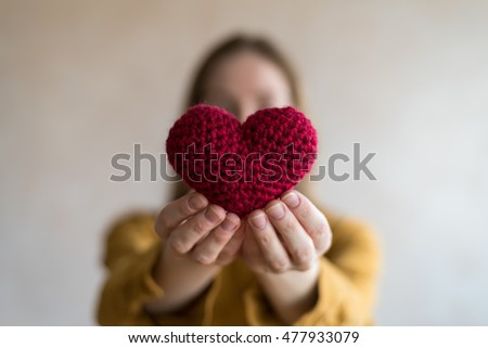 Woman with a crocheted heart
