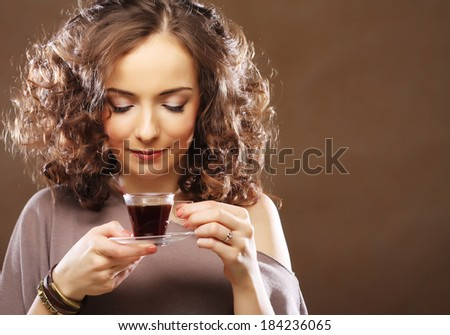 woman with a cup of espresso coffee - stock photo