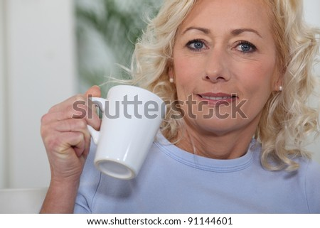 Woman with a cup of tea or coffee