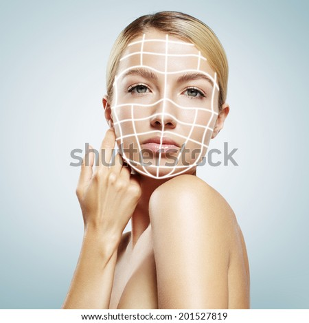 woman with a 3D lines on her face - stock photo