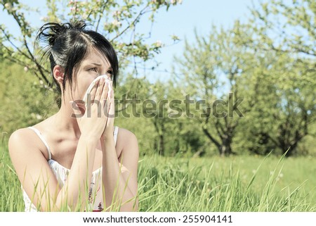 Woman with a flu or an allergy  - stock photo