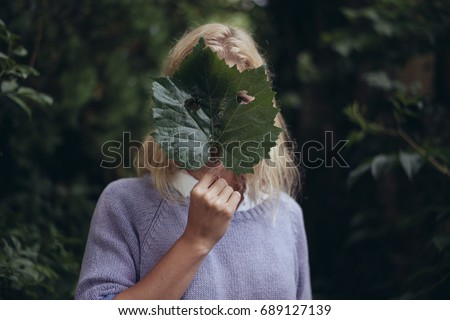 Woman with a Fresh Leaf over Face