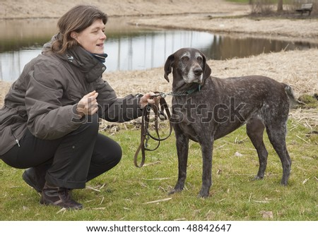 Woman with a German Shorthaired Pointer - stock photo