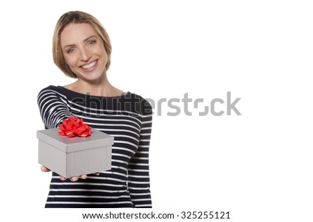 Woman with a gift. Selective focus on the present. - stock photo