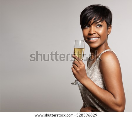 woman with a glass of champagne. Celebrating and smiling - stock photo