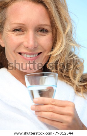 Woman with a glass of water - stock photo