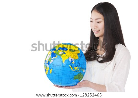 Woman with a globe in his hands - stock photo