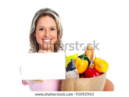 Woman with a grocery bag and a card. Isolated over white background - stock photo