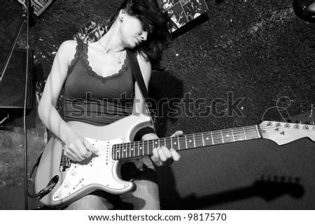 Woman with a guitar - stock photo
