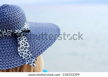 woman with a hat from behind - stock photo