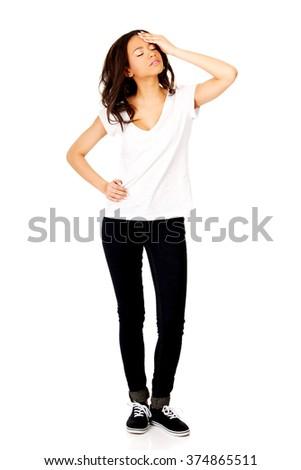 Woman with a headache holding head. - stock photo