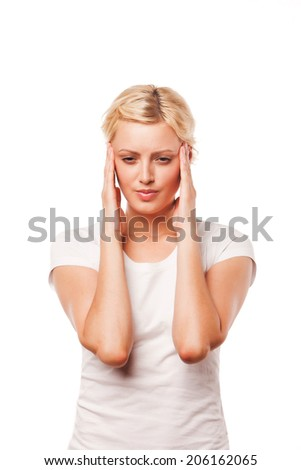 Woman with a headache - isolated over a white background