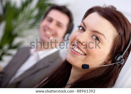 Woman with a headset in a call center - stock photo